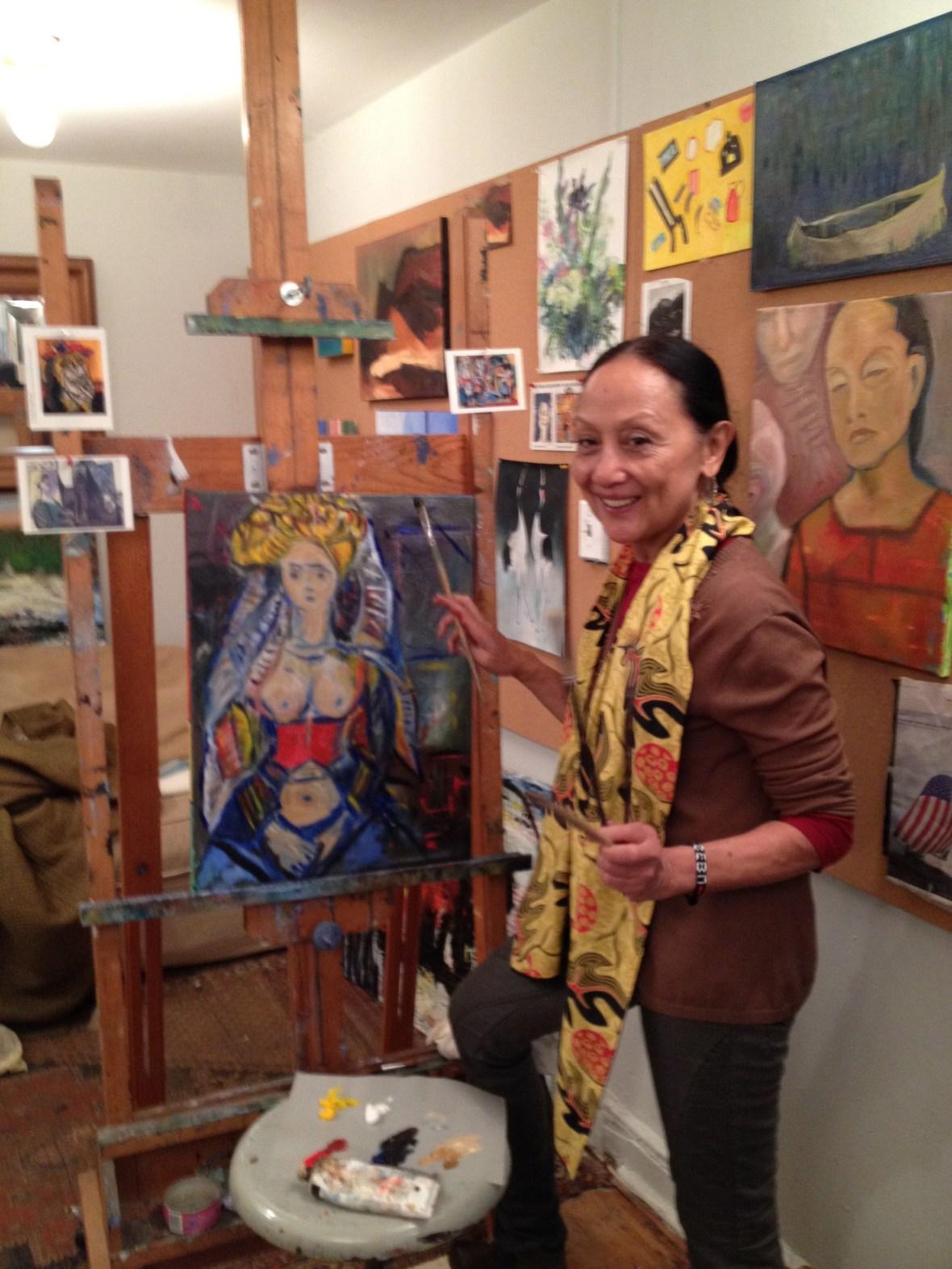 Ching Valdes Aran at work on a new painting | Photo courtesy of CVA