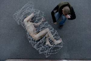 "Pyotr Pavlensky's ""Carcass,"" in front of the City Parliament of St. Petersburg, 2013"