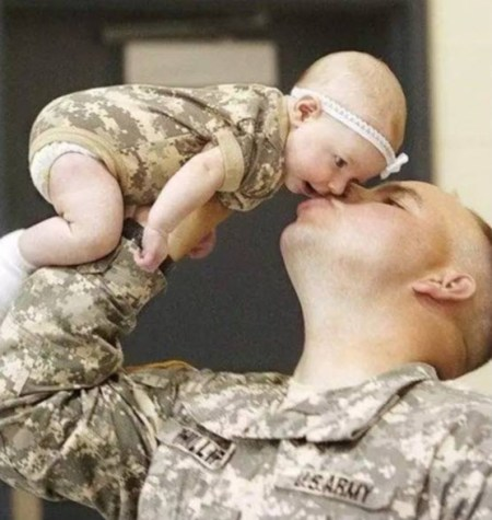 Soldier Kissing Baby