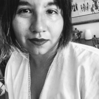 Black and white portrait of the poet, Diana Ayala-Carrillo