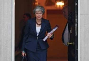 Photograph of British Prime Minister Theresa leaving her office.