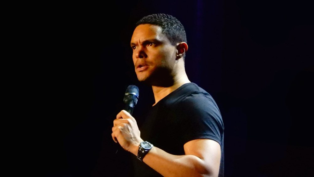 Image of Trever Noah Performing Standup. His cultural diversity can be seen through his skin color.