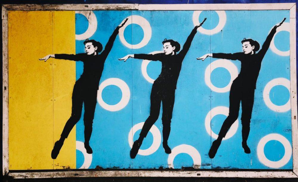 Graffiti art of Audrey Hepburn dancing.