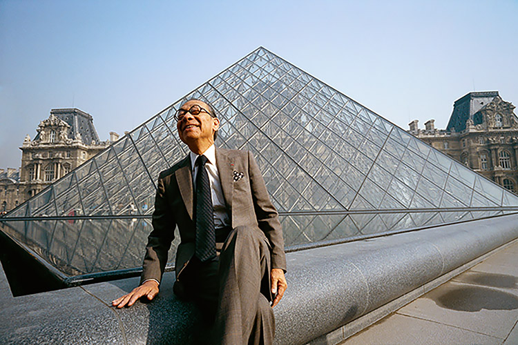 I.M. Pei sitting in front of his most famous project Pyramide du Louvre in Paris, France