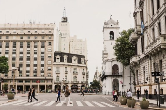 To display the busy streets of Buenos Aires, Argentina where Nader visits.