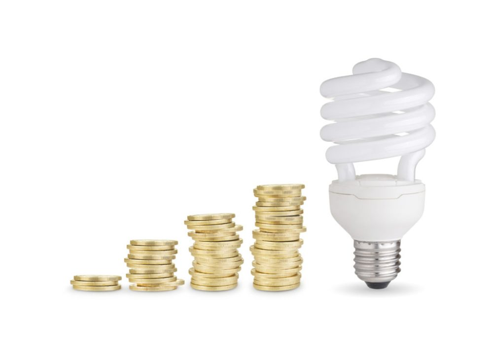 improve the environment and save with stacks of coins and energy saver bulb
