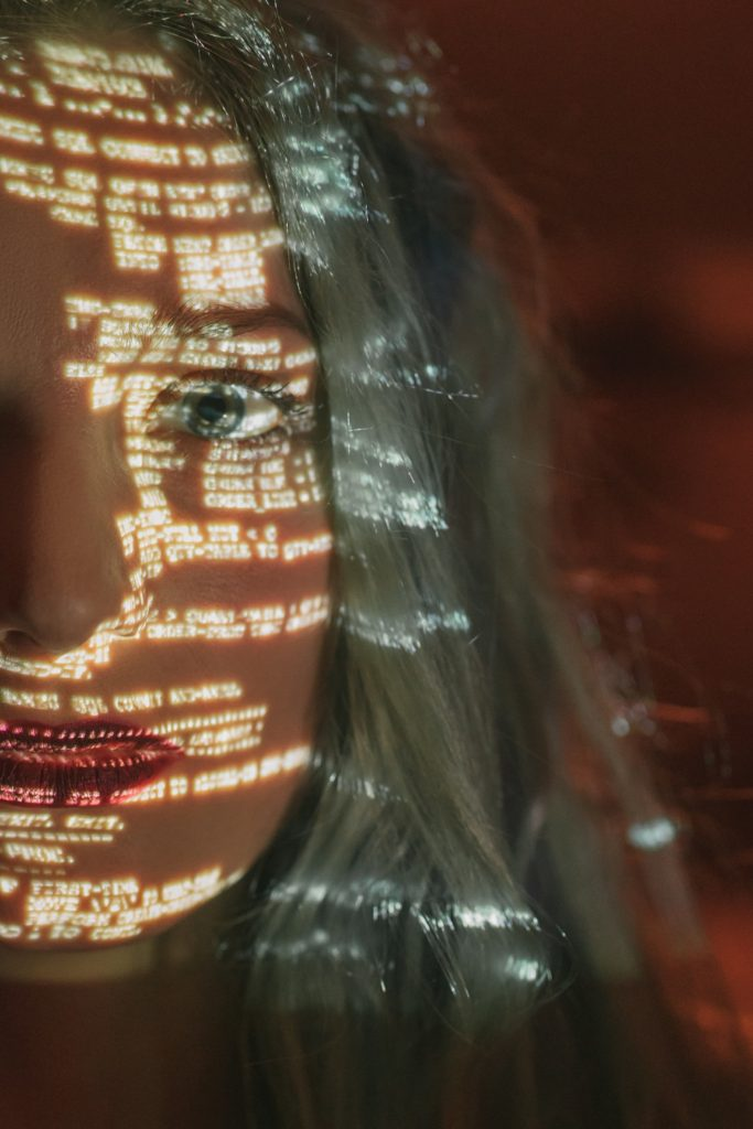 Woman with lines of code across her face.