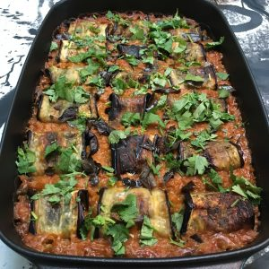 Paneer-stuffed aubergine in red lentil and coconut sauce