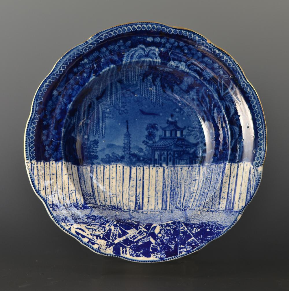 Scott's Cumbrian Blue(s), Palestine 2016. In-glaze decal collage and gold lustre on partially erased Stevenson Palestine bowl c.1820 265mm. dia. Paul Scott 2016