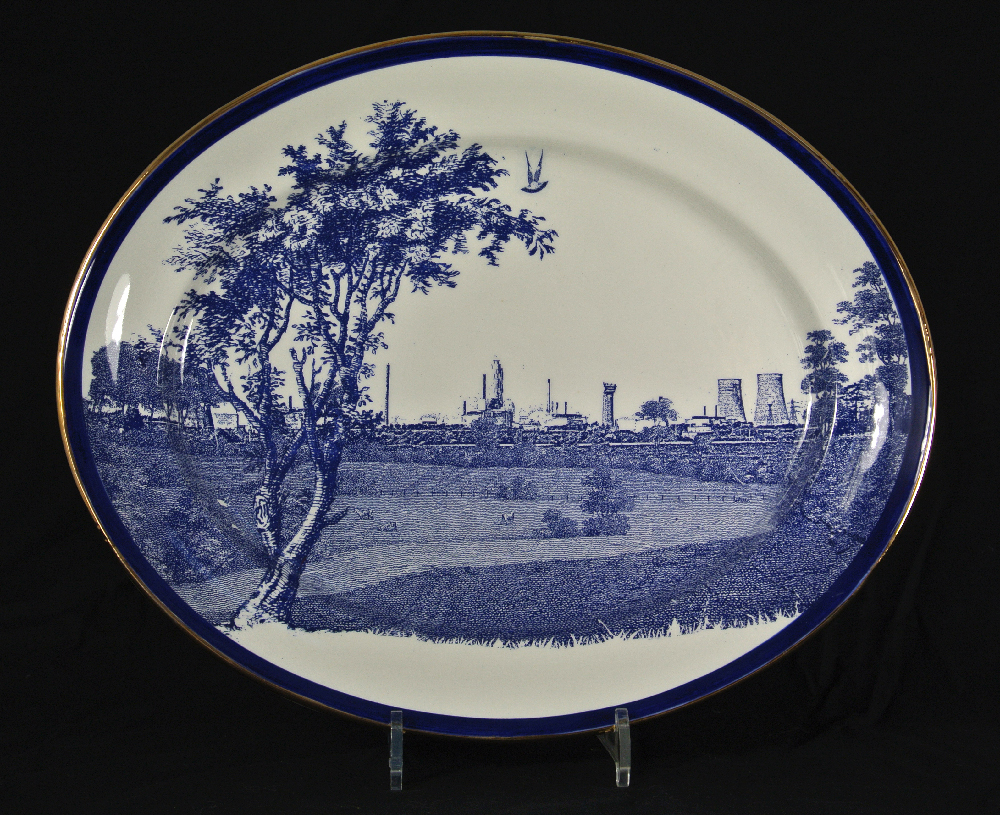 Scott's Cumbrian Blue(s) Seascale Pigeon No 14. Inglaze decal collage and gold lustre on old earthenware platter (c.1930), marked Bristol Poutney and Co, 40cm x 33cm. Paul Scott 2012, V&A Collection.