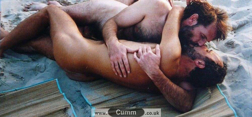 nude men hugging with erections