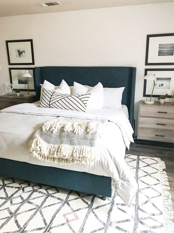 coastal navy bedroom with white bedding