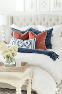 bed with white headboard and pillows