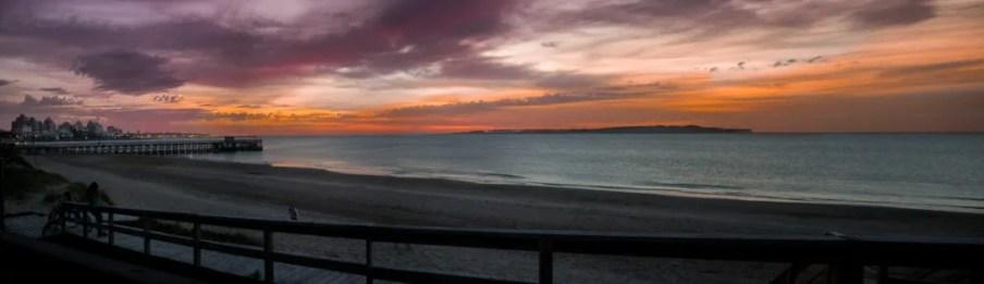 Panoramic sunset over the pier of Punta del Este Uruguay beach