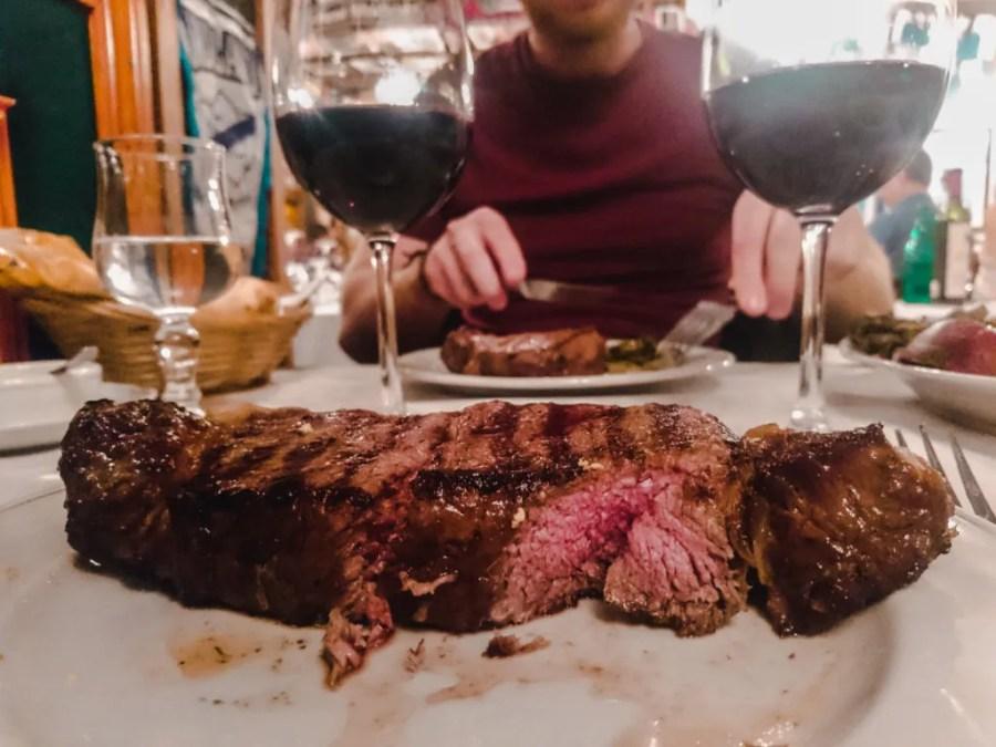 steak argentina buenos aires la brigada beef rare grilled asado red wine merlot restaurant best foods typical south america travel guide