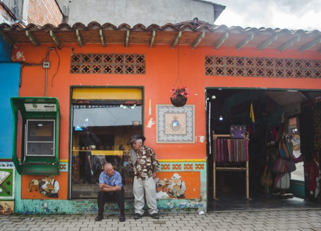Old men in Guatapé - best places for your first time in Latin America if you don't speak Spanish