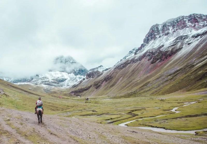 Hiring a horse at Rainbow Mountain trail Cusco Peru tour