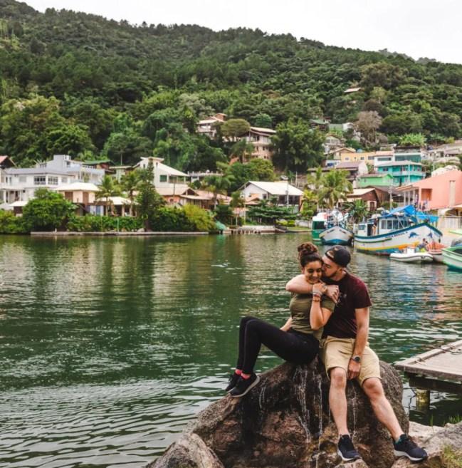 Travel couple at Barra da Lagoa Florianopolis travel guide floripa brazil