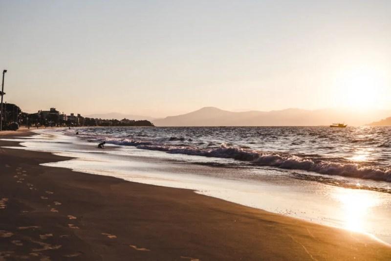 Sunset on Praia Canasvieiras beach where to stay in Florianopolis travel guide floripa brazil where to stay in florianopolis