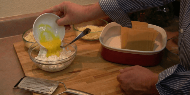 pouring egg into cottage cheese
