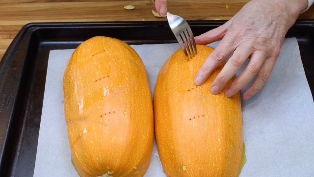 poking holes in squash with a fork