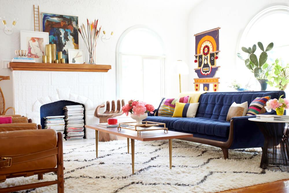 blue furniture living room tv unit modern design 25 stunning rooms with velvet sofas sofa in emily henderson s