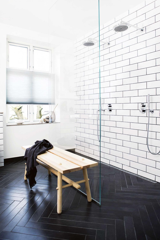 11 bathrooms with black herringbone tiles