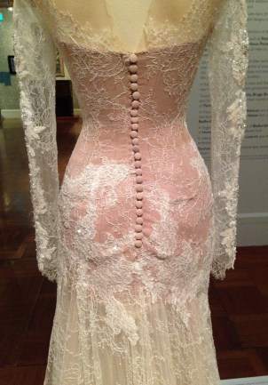 Detail of white lace dress designed by Paul Vasileff and manufactured by Paolo Sebastian in 2013