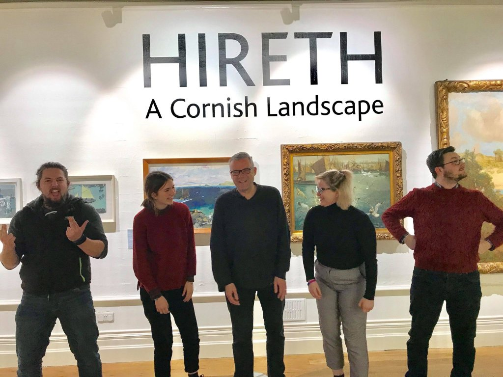 The fantastic participants in the Citizen Curators pilot group at Royal Cornwall Museum. Photo shows five people, three men and two women posing in a gallery at Royal Cornwall Museum.