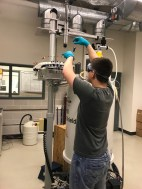 Jason placing his NMR tube on the NMR autosampler