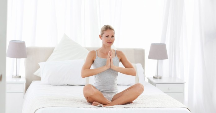 6 Yoga Poses To Practice On Bed After Waking Up