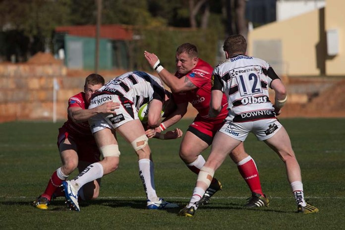 64724405 - vilamoura, portugal-april 2, 2015: rugby players in action in the algarve rugby festival. gloucester xv vs. british army