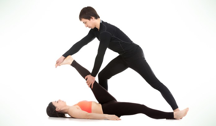 Supta Padangusthasana treats vertigo by providing stability