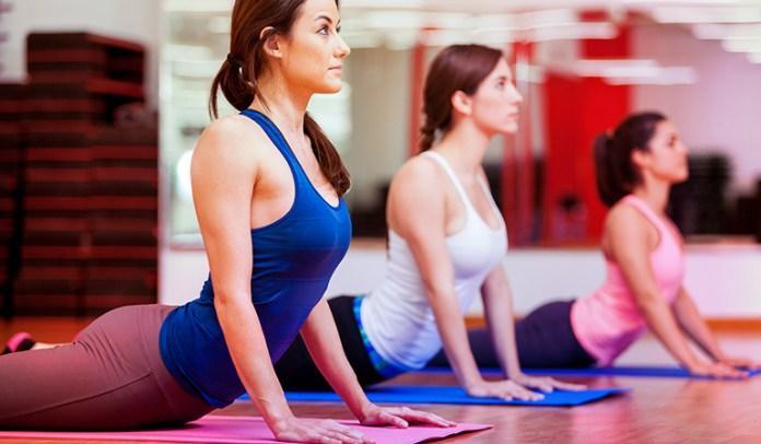 Women practicing yoga in <!-- WP QUADS Content Ad Plugin v. 2.0.26 -- data-recalc-dims=