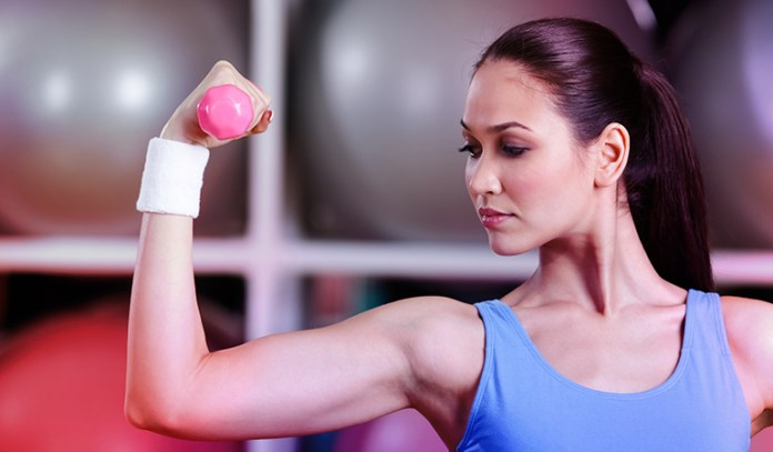Woman practicing lifting during strength training