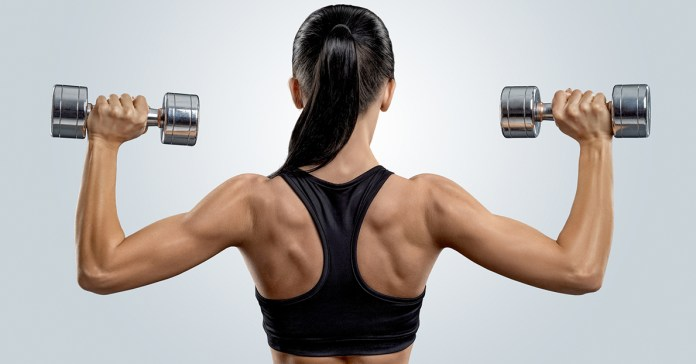 Woman lifting dumbbells during strength training