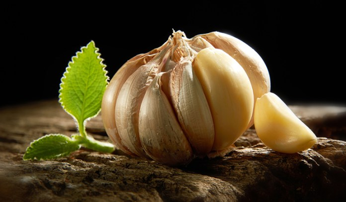Garlic Helps Moles Form A Scab And Fall Off