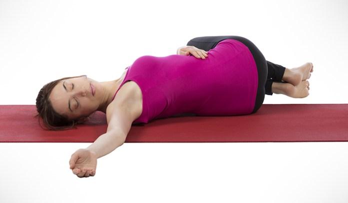 Spine twist stretch relieves constipation