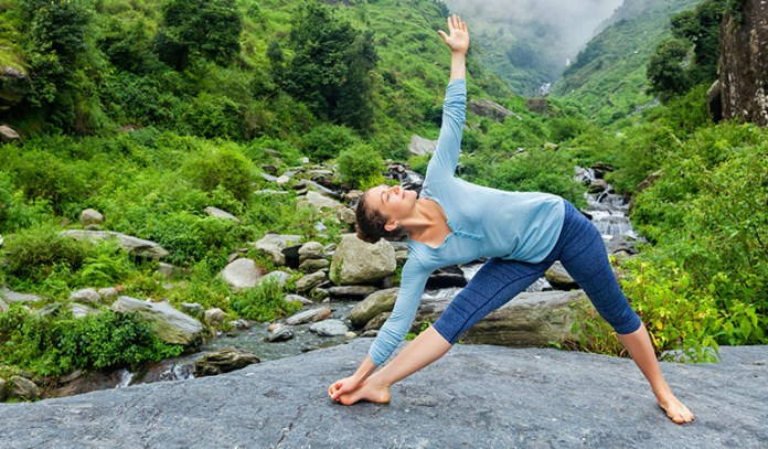 Yoga poses for older beginners Triangle Pose Trikonasana
