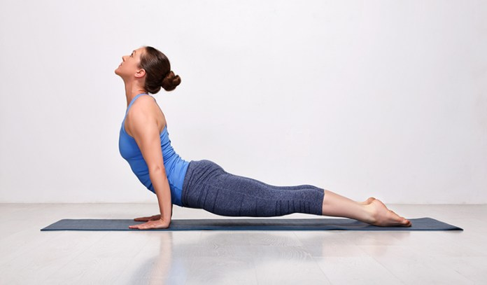 Upward dog pose awakens the nervous system and aligns the spine