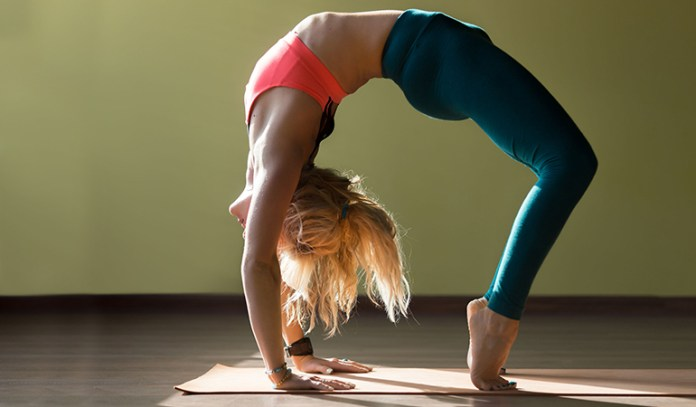 Start with the half wheel pose before getting into the full wheel to avoid back pain