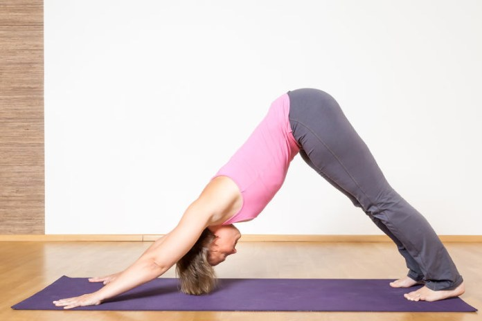 The downward facing dog pose helps relieve tight hips