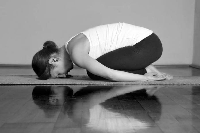 Balasana helps relieve stress and removes toxins from the body