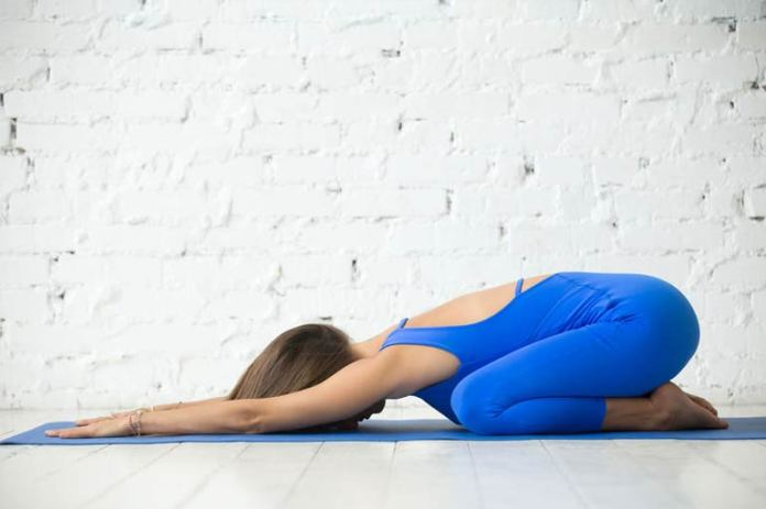 Balasana II stretches the lower back, hips, and knees