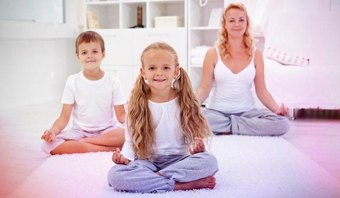 Sitting pose eases the child into a yoga session.