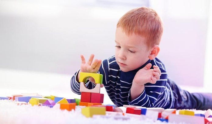 Let your kids play with large wooden blocks to groom their motor skills.