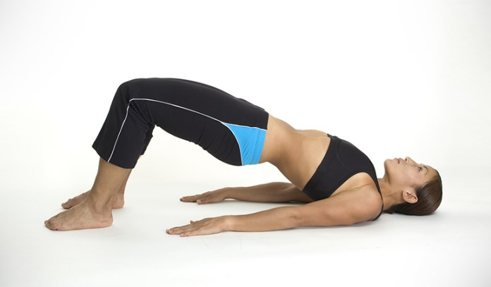 Bridge pose is an exercise that can help you get a thigh gap