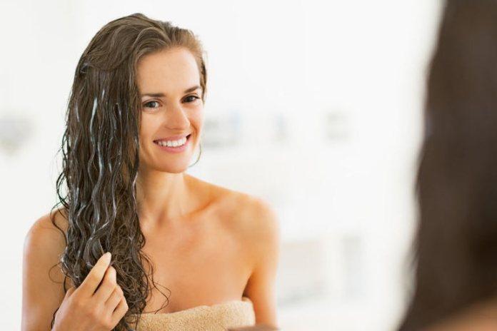 A coconut oil hair mask helps deep condition your hair.