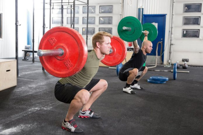 Adding weights to squats increases resistance and makes them more effective