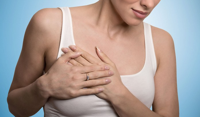 Fibrocystic breast disease causes lumpy breasts and breast pain.